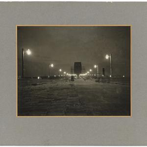 View of Sydney Harbour Bridge at night, showing lights on, ca. 1931