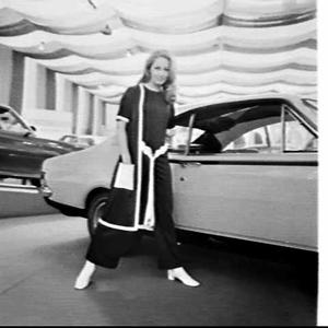Fashion model poses with Holden car at the Motor Show, Sydney Showground